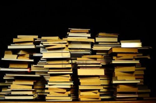 Big-pile-of-books-in-black-background
